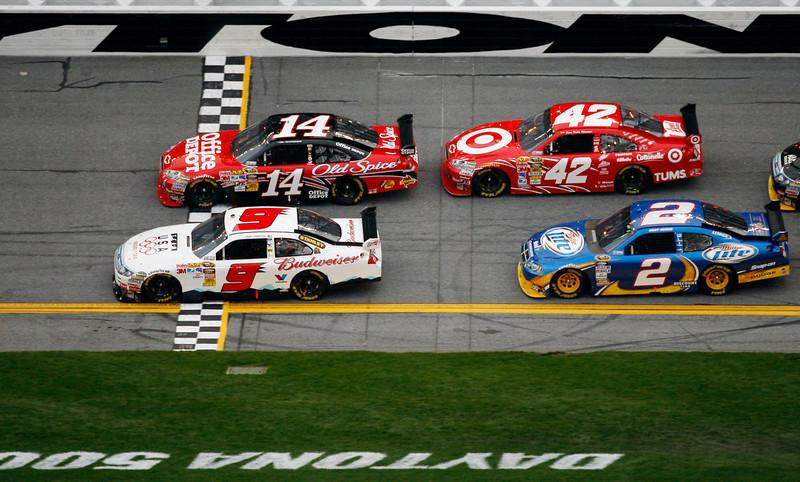. Driver Kasey Kahne (9) wins the second of two  NASCAR Gatorade Duel qualifying auto races in Daytona Beach, Fla., Thursday, Feb. 11, 2010, beating Tony Stewart (14), Juan Pablo Montoya (42) and Kurt Busch (2) across the finish line. (AP Photo/J Pat Carter)