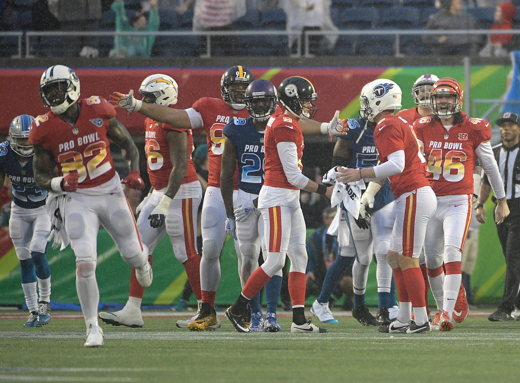 . AFC placekicker Chris Boswell (9), of the Pittsburg Steelers congratulates punter Brett Kern (6), of the Tennessee Titans, after scoring a field goal during the last minutes of the second half of the NFL Pro Bowl football game, Sunday, Jan. 28, 2018, in Orlando, Fla. The AFC defeated the NFC 24-23. (AP Photo/Phelan M Ebenhack)