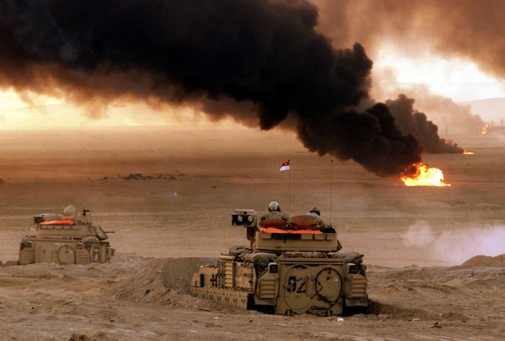 Description of . Flames erupt from targets during joint live fire exercises by the United States and Kuwaiti militaries at Udari, Kuwait, 20 miles from the Iraqi border Sunday, February 25, 2001. The exercises were held on the 10th anniversary of the liberation of Kuwait from Iraq, with former President George Bush and General Norman Schwarzkopf in attendance. (AP Photo/John McConnico)