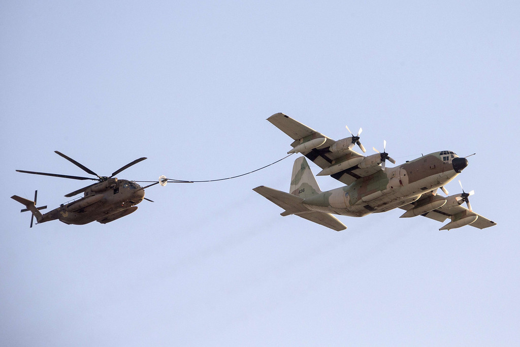 . An Israeli C-130 Hercules plane refuels a Sikorsky CH-53K helicopter during an air show at the graduation ceremony of Israeli pilots in the Hatzerim air force base in the Negev desert, near the southern Israeli city of Beersheva on December 26, 2013. AFP PHOTO /JACK GUEZ/AFP/Getty Images