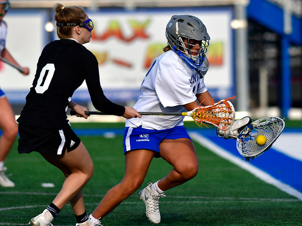 3/14/2019 Mike Orazzi | Staff CCSU's Jackie Branthover (12) and Presbyterian College's Kara DiClemente (0) during Thursday's women's lacrosse in New Britain.