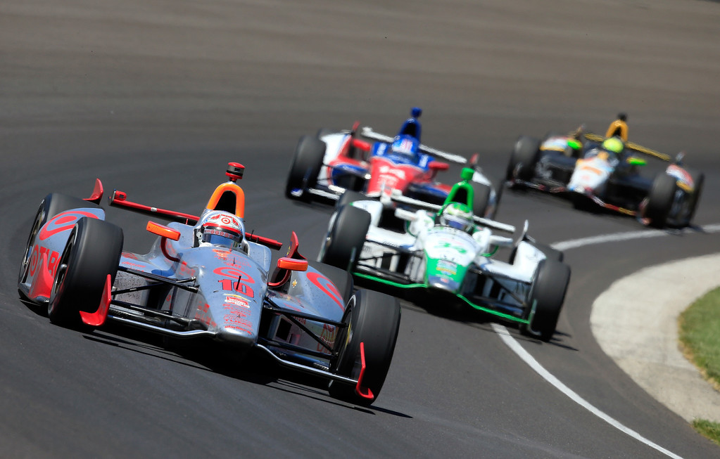 . Tony Kanaan, driver of the #10 Target Chip Ganassi Racing Honda, in action during the 98th running of the Indianapolis 500 Mile Race at Indianapolis Motorspeedway on May 25, 2014 in Indianapolis, Indiana.  (Photo by Jamie Squire/Getty Images)