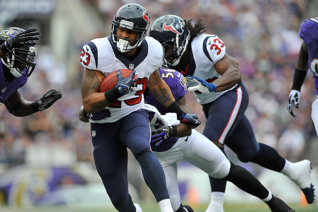 . Running back Arian Foster #23 of the Houston Texans runs the ball against the Baltimore Ravens at M&T Bank Stadium on September 22, 2013 in Baltimore, Maryland.  (Photo by Larry French/Getty Images)