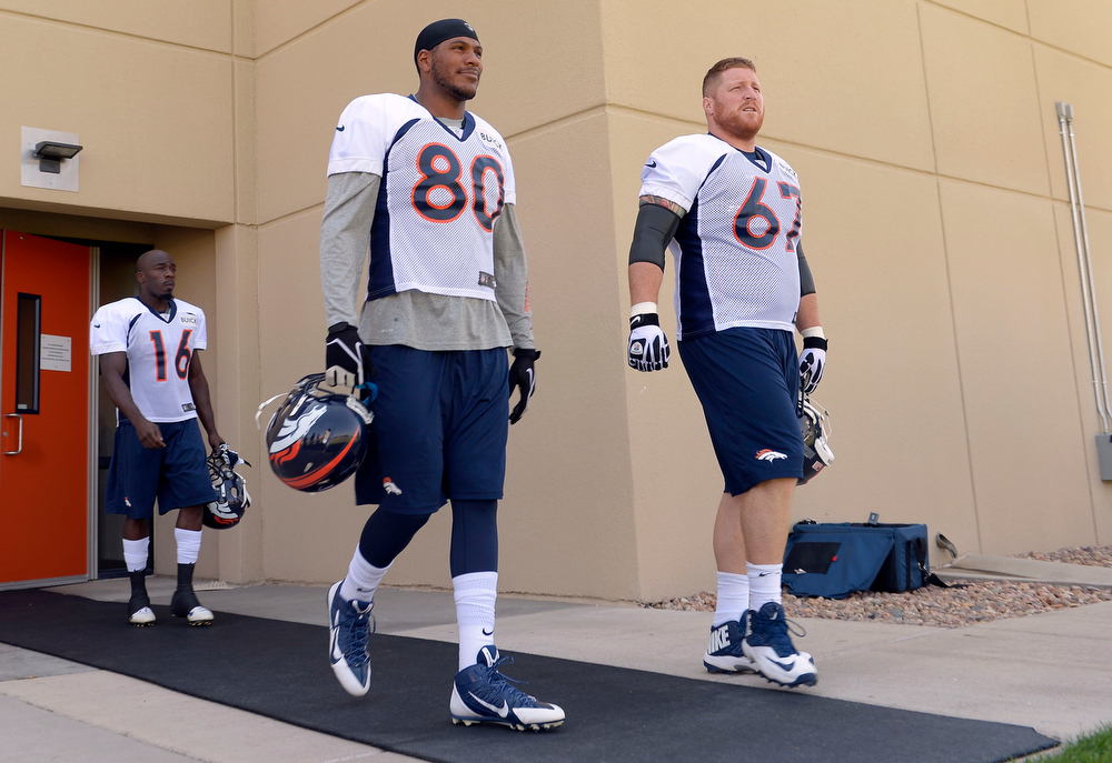 . Denver Broncos TE Julius Thomas (80) and Dan Koppen (67) walk out to the field during training camp July 26, 2013 at Dove Valley. (Photo By John Leyba/The Denver Post)