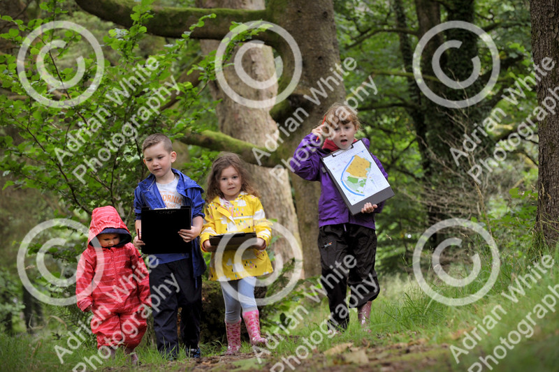 The Brecon Beacons National Park open invitation to join in its 60th Anniversary celebrations at Party in the Park at Craig-y-nos Country Park.  Elin Jones aged 2, Garin Thomas aged 7, Harriet Morgan aged 3 and Catrin Jones aged 6 orienteering in the woods of Craig-y-nos Country Park.