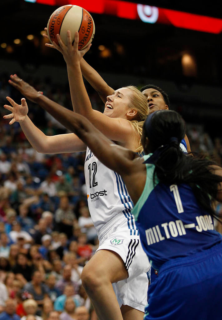 . Minnesota Lynx forward Rachel Jarry  pushes the ball up to the basket against New York Liberty forward DeLisha Milton-Jones  in the second half. (AP Photo/Stacy Bengs)