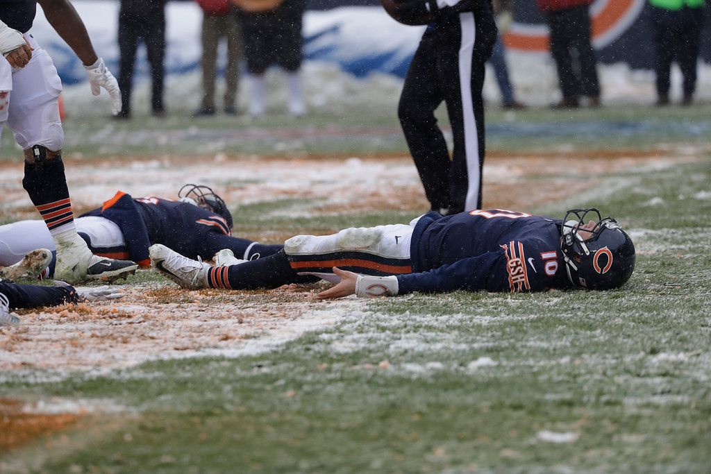 . Chicago Bears quarterback Mitchell Trubisky (10) performs a snow angel in the end zone after scoring against the Cleveland Browns in the second half of an NFL football game in Chicago, Sunday, Dec. 24, 2017. (AP Photo/Nam Y. Huh)