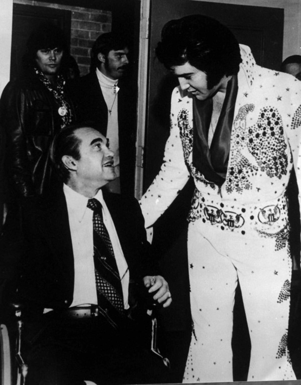 . Alabama Gov. George C. Wallace is shown with singer Elvis Presley following a performance in Montgomery in 1974.  (AP Photo)