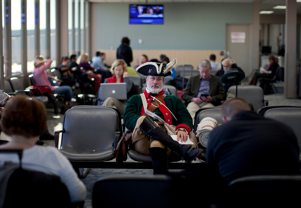 . In this Jan. 4, 2012 file photo, tea party supporter William Temple, of Brunswick, Ga., sits in the Des Moines Airport heading to go home after the Iowa caucus in Des Moines, Iowa.  (AP Photo/Evan Vucci, File)