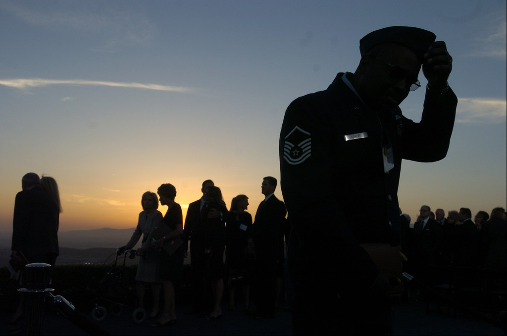 . 6/11/04--Simi Valley-- Military officer bows his head at the end of the funeral services for the 40th President at the Ronald Reagan Library in Simi Valley, Ca, Friday, June 11th, 2004.   (Los Angeles Daily News file photo)