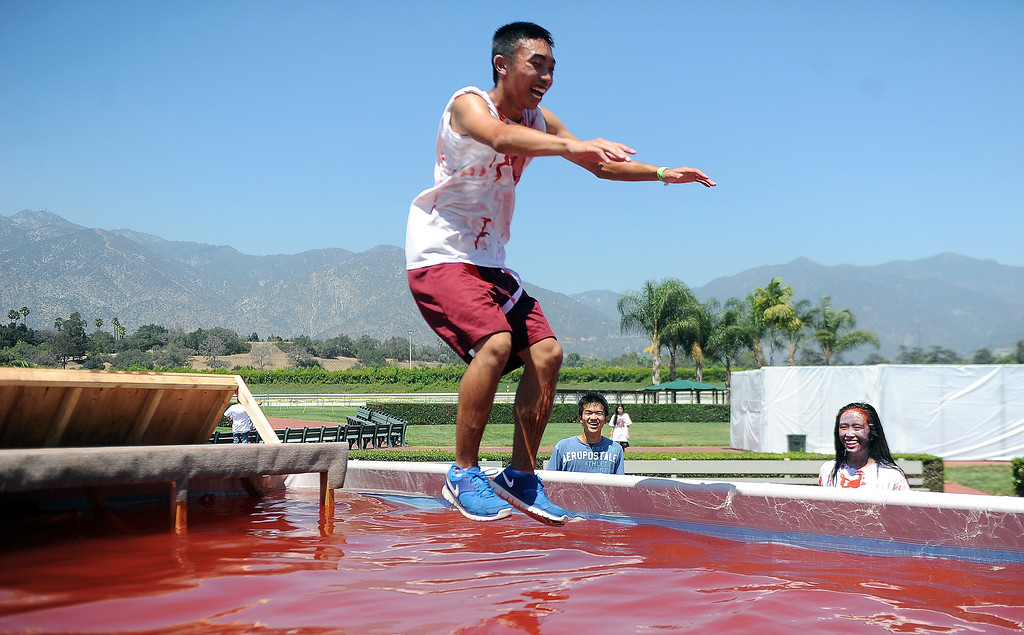 . Seventeen year-old Calvin Khuat of Rosemead leaps into the pool of blood during the Zombie Blood Run at Santa Anita Park on Saturday, Aug. 17, 2013 in Arcadia, Calif. The American Red Cross San Gabriel Pomona Valley chapter is partnering with the Zombie Blood Run to prepare the San Gabriel Valley for a disaster, even a zombie apocalypse.  (Keith Birmingham/Pasadena Star-News)