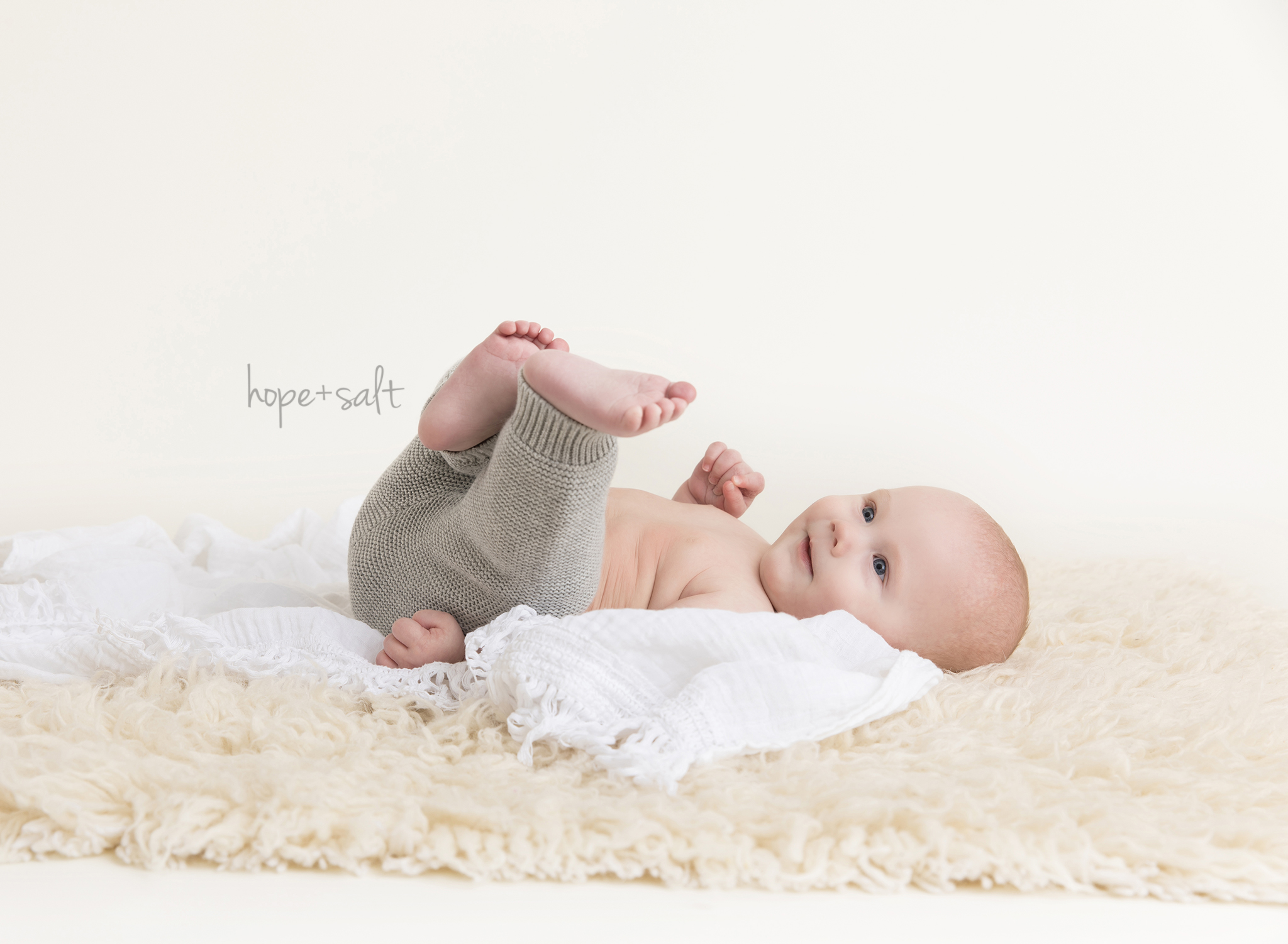 burlington baby photographer - six month old sitter boy Nathan studio session with all neutral fabrics and props