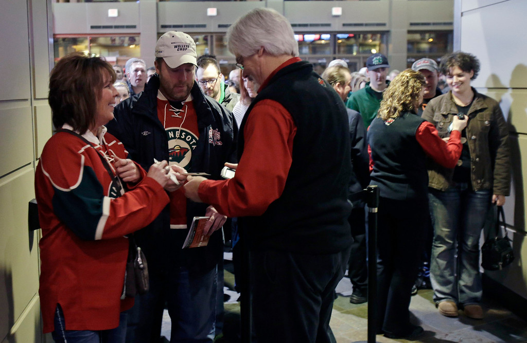 . Minnesota Wild hockey fans arrive for an NHL lockout-shortened season as the Wild host the Colorado Avalanche, Saturday, Jan. 19, 2013, in St. Paul, Minn. (AP Photo/Jim Mone)