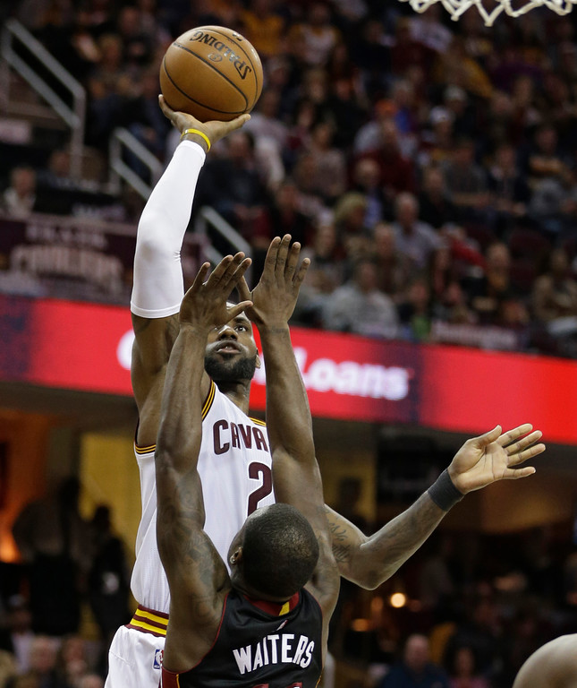 . Cleveland Cavaliers\' LeBron James (23) shoots over Miami Heat\'s Dion Waiters (11) in the first half of an NBA basketball game, Monday, March 6, 2017, in Cleveland. (AP Photo/Tony Dejak)