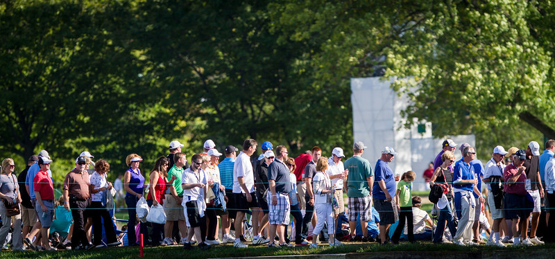 Crowds cross the fairway at the BMW Championship in Carmel Indiana on Saturday Sept. 8, 2012. (Charles Cherney/WGA)