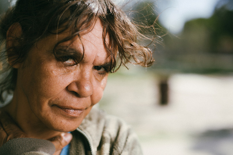 Indigenous Australian Woman with her Hair Blowing in the Wind