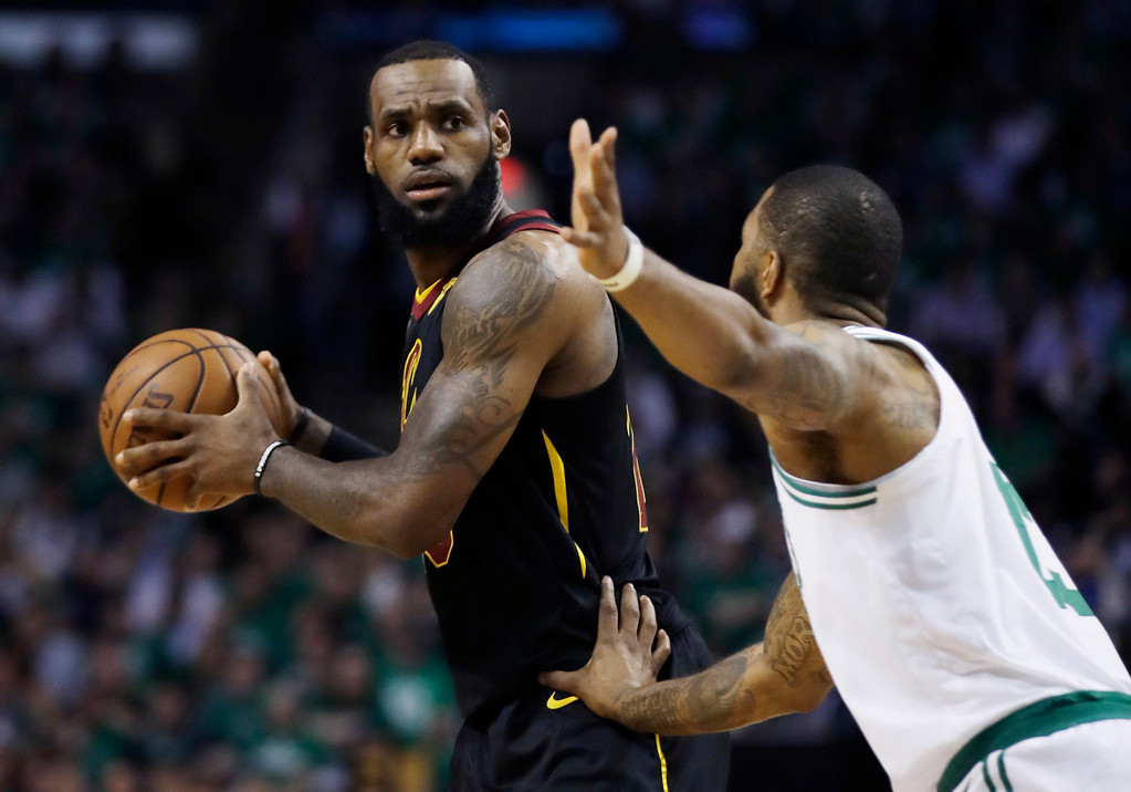 . Cleveland Cavaliers forward LeBron James keeps the ball from Boston Celtics forward Marcus Morris during the first quarter of Game 5 of the NBA basketball Eastern Conference finals Wednesday, May 23, 2018, in Boston. (AP Photo/Charles Krupa)