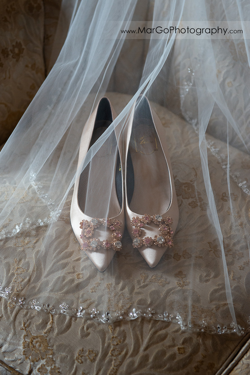 wedding shoes with flower decor under white veil at Long Branch Saloon & Farms in Half Moon Bay