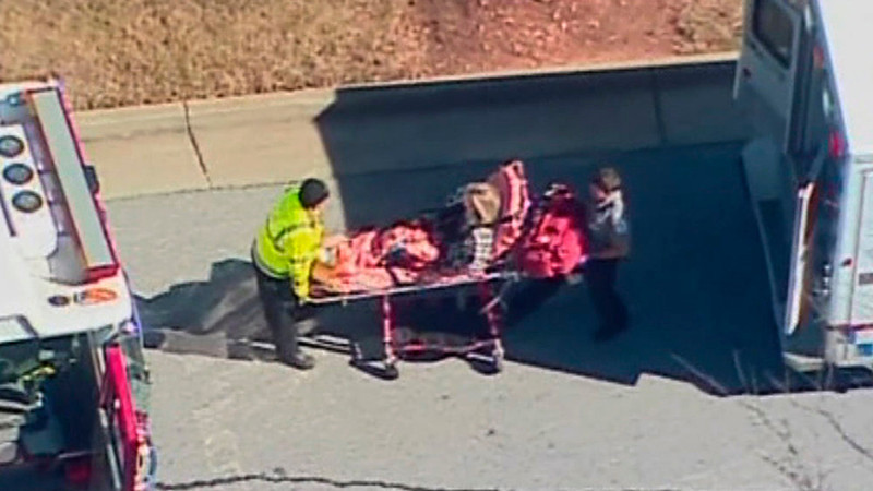 . A 14-year old student is wheeled to an ambulance after a shooting in this still image taken from video outside Price Middle School in Atlanta, Georgia January 31, 2013.  A male student was arrested according to police reports in the latest outbreak of gun violence in a U.S. School.  REUTERS/WXIA-TV/NBC/Handout