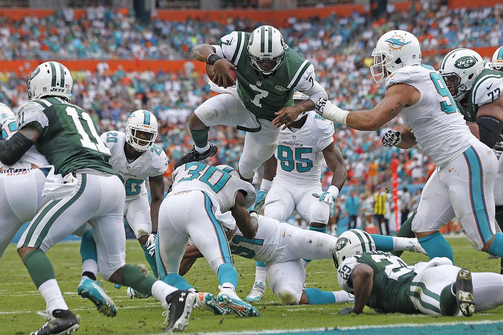 . Geno Smith #7 of the New York Jets dives for the end zone but is stopped short by the Miami Dolphins defense during second quarter action on December 29, 2013 at Sun Life Stadium in Miami Gardens, Florida. (Photo by Joel Auerbach/Getty Images)