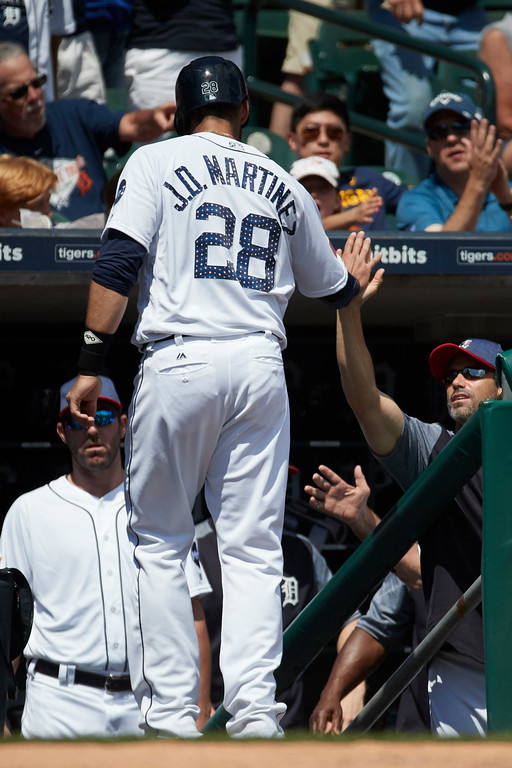. Detroit Tigers J.D. Martinez receives congratulations from manager Brad Ausmus after scoring in the seventh inning against the Cleveland Indians in the first baseball game of a doubleheader in Detroit, Saturday, July 1, 2017. (AP Photo/Rick Osentoski)