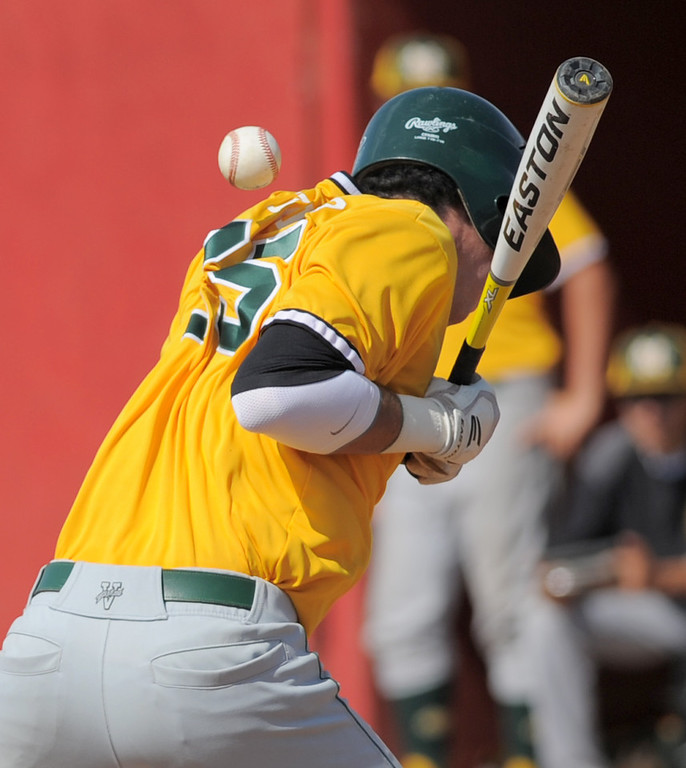 . 05-28-2013-( Sean Hiller/LANG) Mira Costa beat Elsinore 5-3 in Tuesday\'s CIF Southern Section Division III semifinal at Elsinore High School. Costa\'s Jack Webber gets hit by the ball and moves to first base.