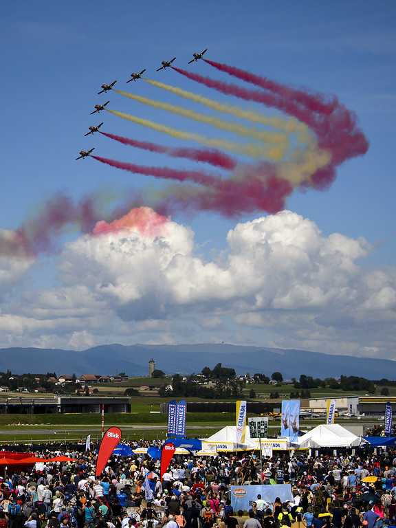 ". The Spanish Air Force\'s ""Patrulla Aguila\"" aerobatic team performs on the first day of the AIR14 air show in Payerne, western Switzerland, on August 30, 2014. AFP PHOTO / FABRICE COFFRINI/AFP/Getty Images"