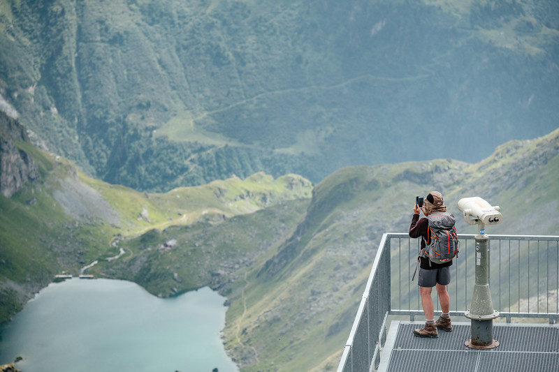 A man photographing the landscape at Mont Fort Verbier