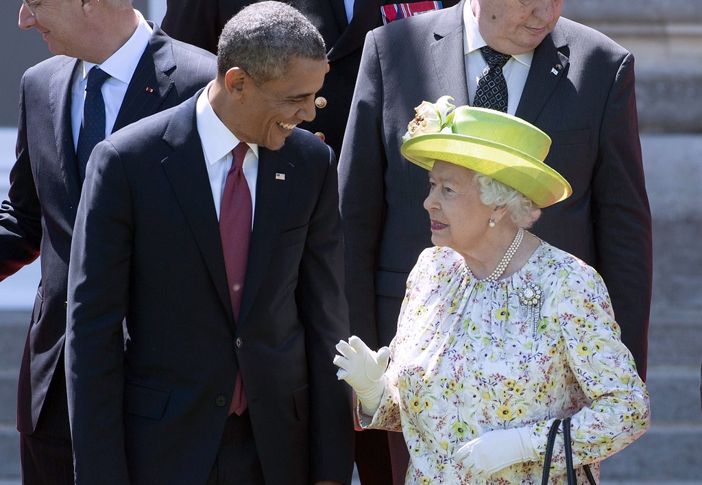 . Queen Elizabeth II speaks with US President Barack Obama during a group photo of world leaders attending the D-Day 70th Anniversary ceremonies at Chateau de Benouville in Benouville, France, June 6, 2014.  AFP PHOTO / Saul LOEB/AFP/Getty Images
