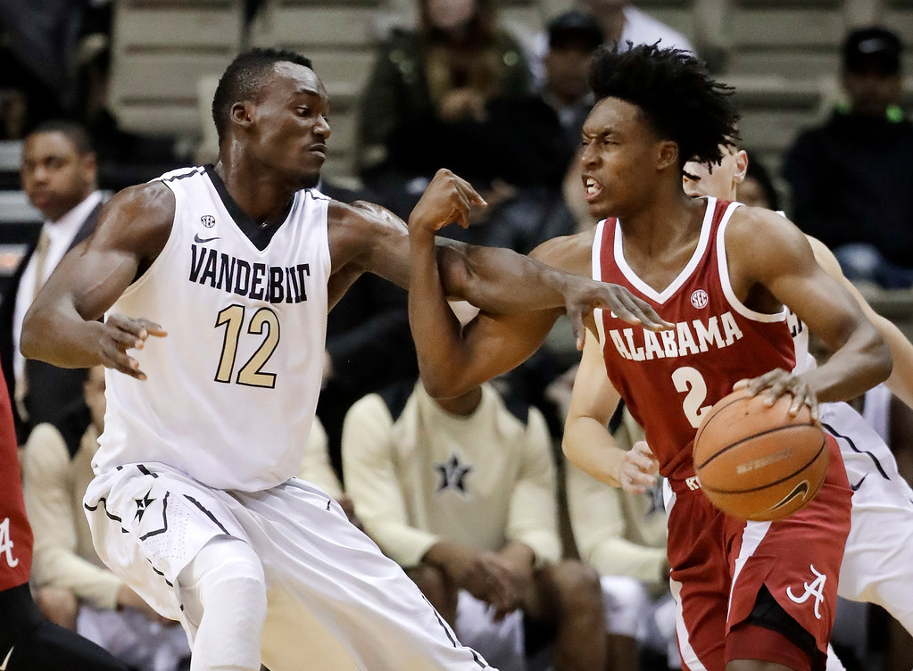. Vanderbilt center Djery Baptiste (12) defends against Alabama guard Collin Sexton (2) in the first half of an NCAA college basketball game Tuesday, Jan. 2, 2018, in Nashville, Tenn. (AP Photo/Mark Humphrey)