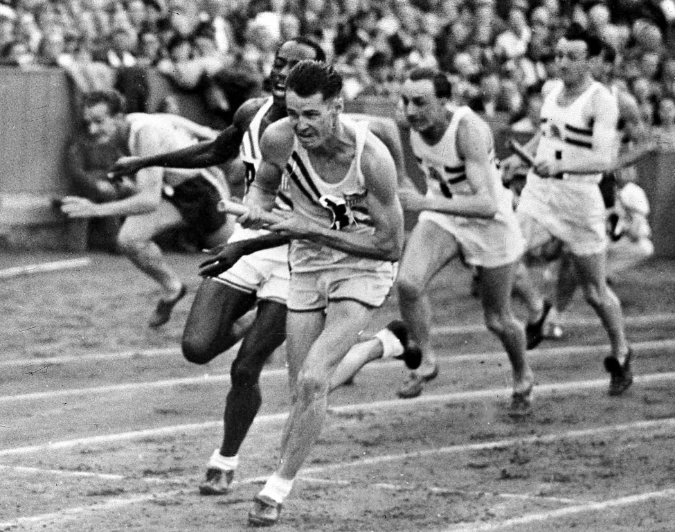 . America\'s Harrison Dillard, second left, hands over the baton to Melvin Patton, third left, for the final leg of the men\'s Olympic Games 4 x 100metres Relay Final at Wembley Stadium, London, Aug. 7, 1948, to win the race. Britain\'s John Archer, second right, came in second. The American team were disqualified for a wrong baton change. (AP Photo)