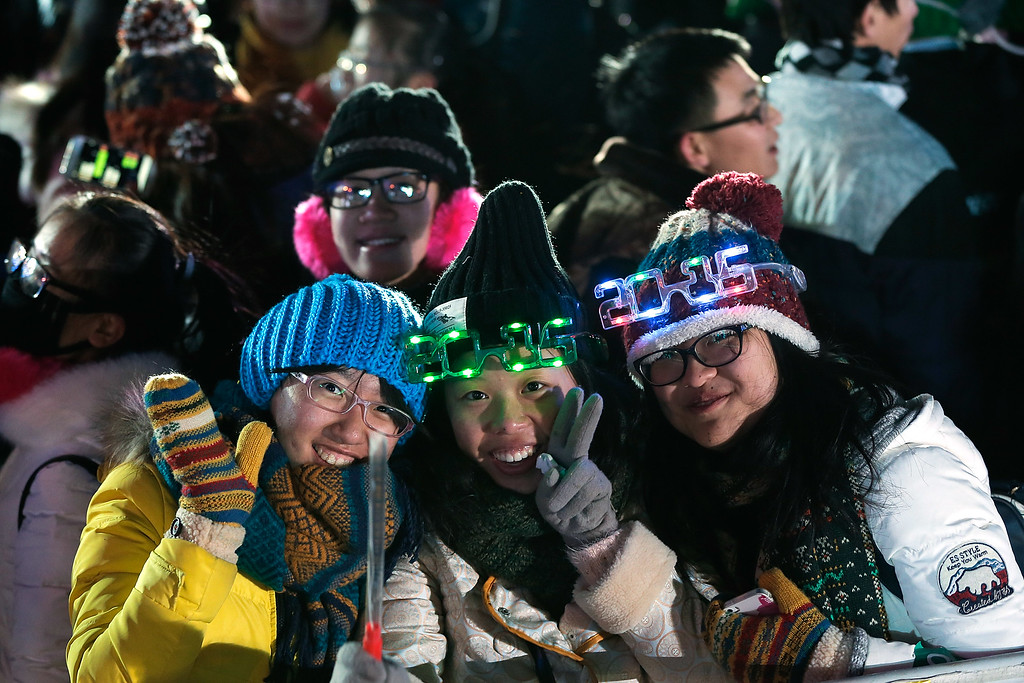 . BEIJING, CHINA - DECEMBER 31:  Chinese people celebrate the New Year during a New Year\'s eve countdown event to promote the city\'s 2022 Winter Olympic bid at Olympic Park on December 31, 2014 in Beijing, China.  (Photo by Lintao Zhang/Getty Images)