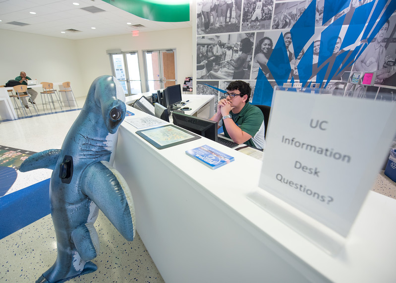 Hunter chats with student worker  Andrew Deases at the Information Desk in the University Center.  Join us in celebration of Shark Week at Brewster Street Icehouse: http://bit.ly/2taqLoa