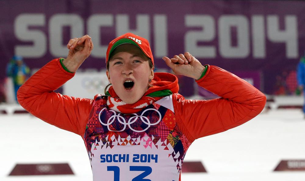 . Belarus\' Darya Domracheva celebrates winning the gold medal in the women\'s biathlon 15k individual race, at the 2014 Winter Olympics, Friday, Feb. 14, 2014, in Krasnaya Polyana, Russia. (AP Photo/Lee Jin-man)