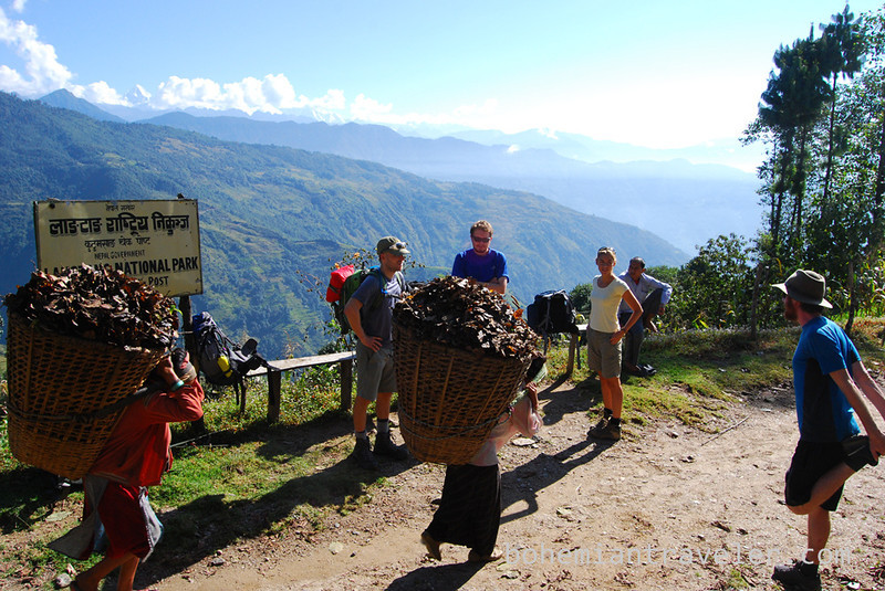 Locals carrying heavy loads.