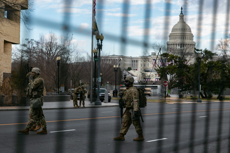 A group of National Guard troops patrol near the U.S. Capitol as the inauguration begins
