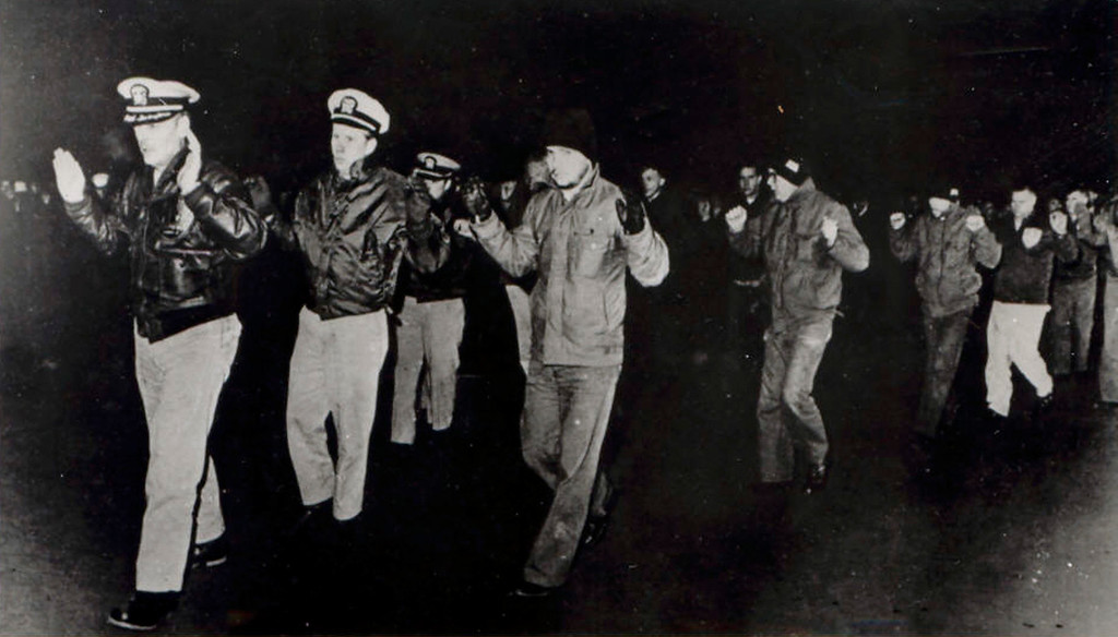. FILE - In this photo released by the U.S. Navy, crew members of the USS Pueblo hold up their hands while in captivity in North Korea in 1968. Many of the crew who served on the vessel, then spent 11 months in captivity in North Korea, want to bring the Pueblo home. Throughout its history, they argue, the Navyís motto has been ìdonít give up the ship.î The Pueblo, in fact, is still listed as a commissioned U.S. Navy vessel, the only one being held by a foreign nation. (AP Photo/US Navy)
