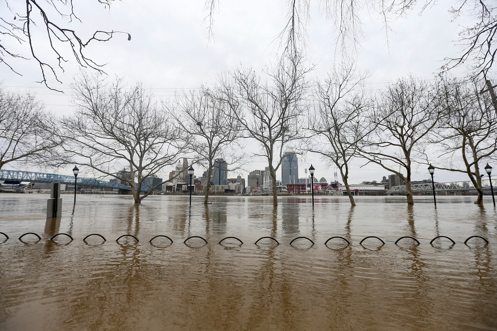 . Water rises from a view looking north to Cincinnati at the confluence of the Licking and Ohio Rivers, Sunday, Feb. 25, 2018. The weather service said moderate flooding was expected along the Ohio River in Kentucky and Ohio, including in Cincinnati, where the river was 8 feet above flood stage Sunday. (Kareem Elgazzar/The Cincinnati Enquirer via AP)