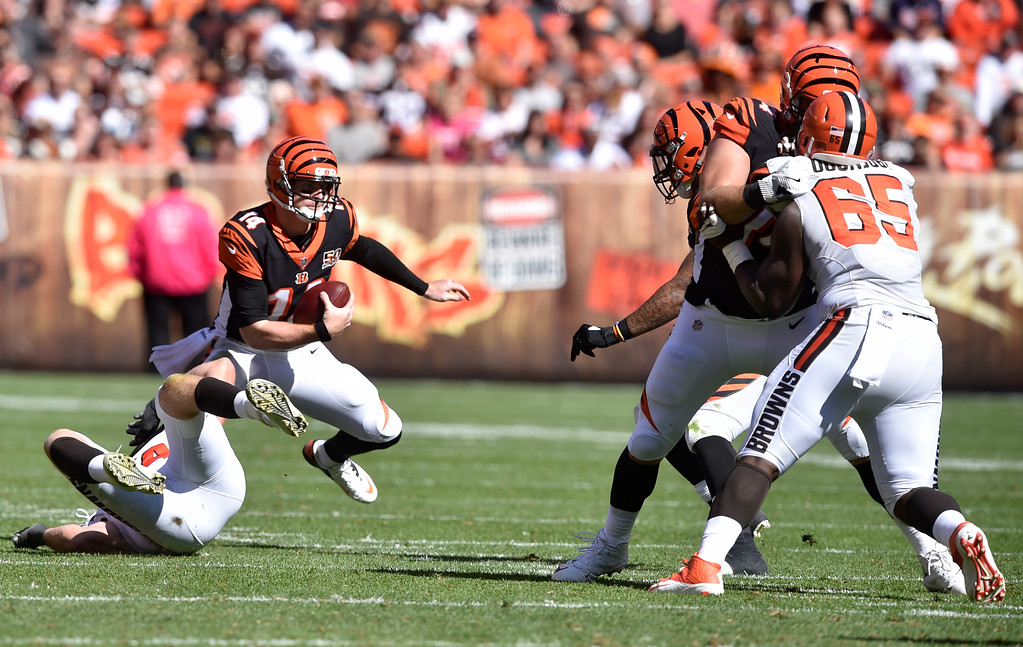 . Cincinnati Bengals quarterback Andy Dalton (14) scribbles in the second half of an NFL football game against the Cleveland Browns, Sunday, Oct. 1, 2017, in Cleveland. (AP Photo/David Richard)