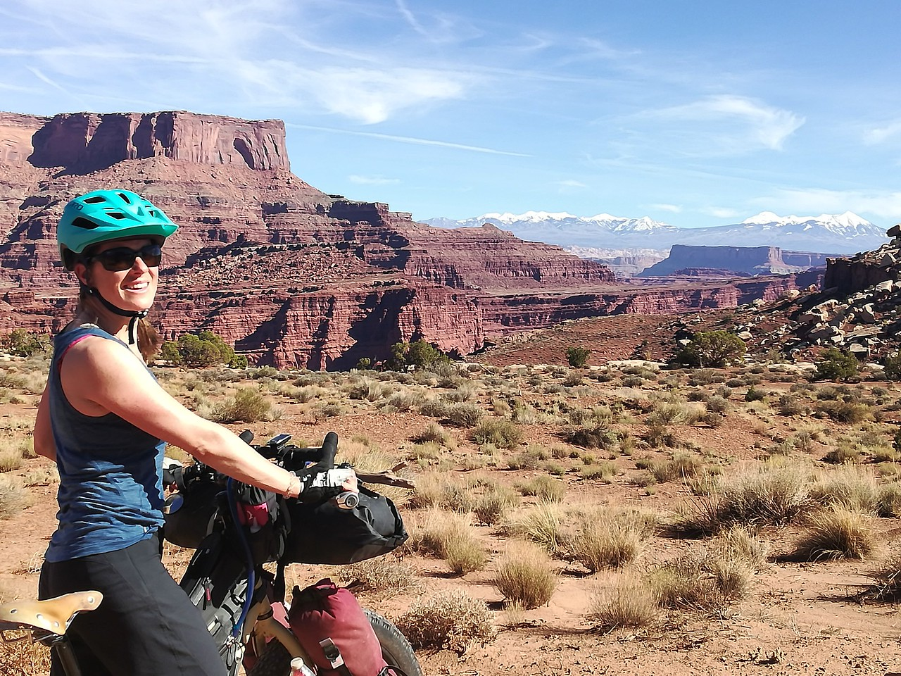 Julie riding on the White Rim of Canyonlands