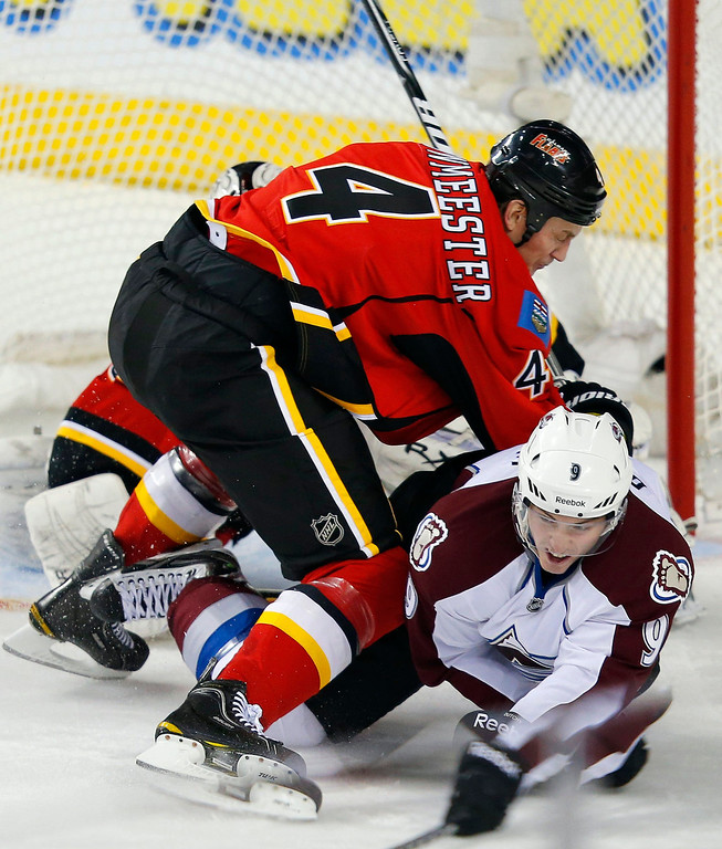 . Calgary Flames\' Jay Bouwmeester (L) knocks Colorado Avalanche\' Matt Duchene to the ice during the first period of their NHL hockey game in Calgary, Alberta, January 31, 2013. REUTERS/Todd Korol