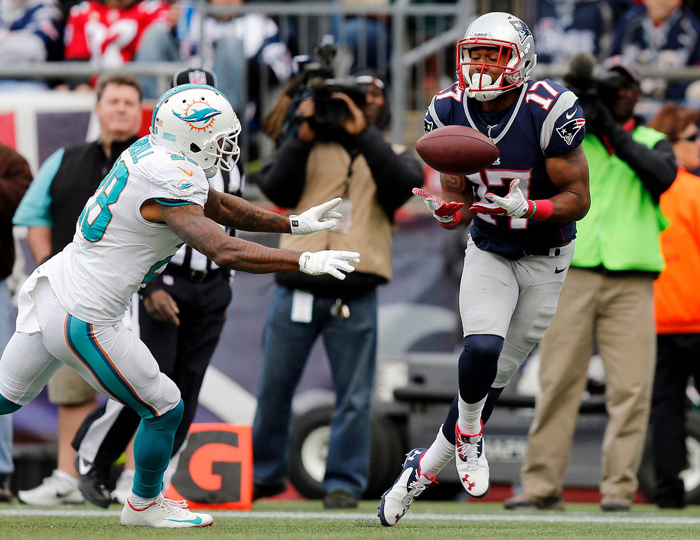 . New England Patriots wide receiver Aaron Dobson (17) catch a touchdown pass in front of Miami Dolphins cornerback Nolan Carroll (28) in the second half of an NFL football game Sunday, Oct. 27, 2013, in Foxborough, Mass. (AP Photo/Michael Dwyer)