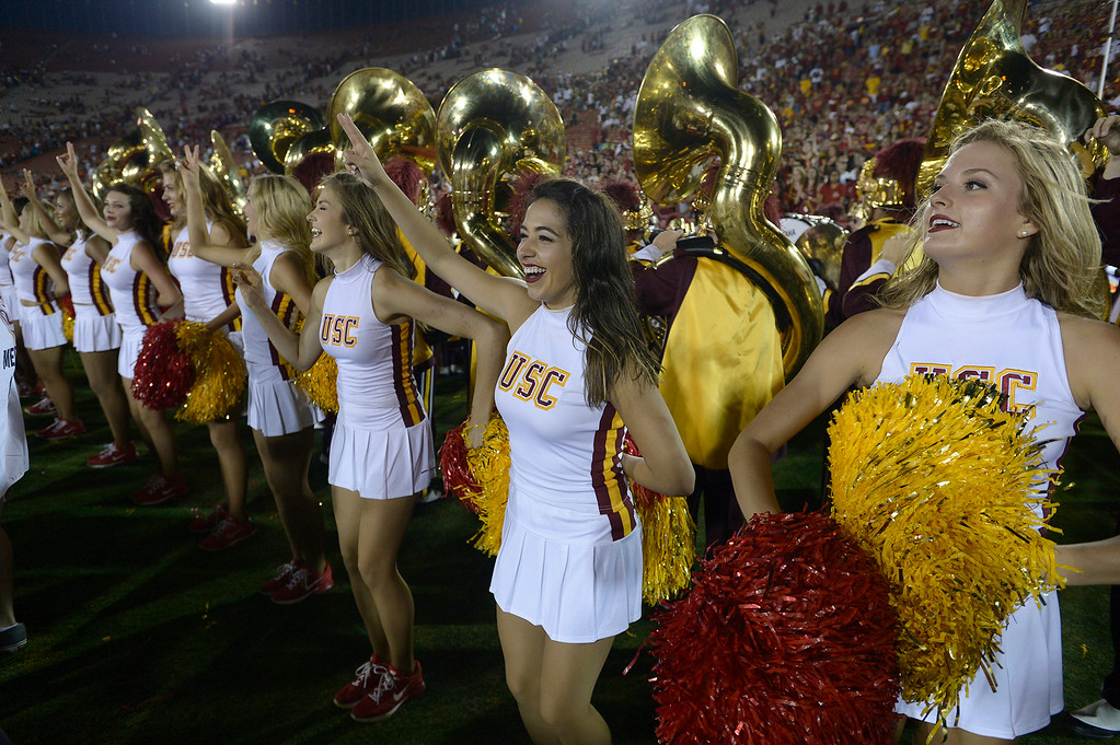 . USC Song girls cheer for the team after the win. USC defeated Fresno State 52-13 at the Los Angeles Memorial Coliseum. Los Angeles, CA. 8/30/2014(Photo by John McCoy Daily News