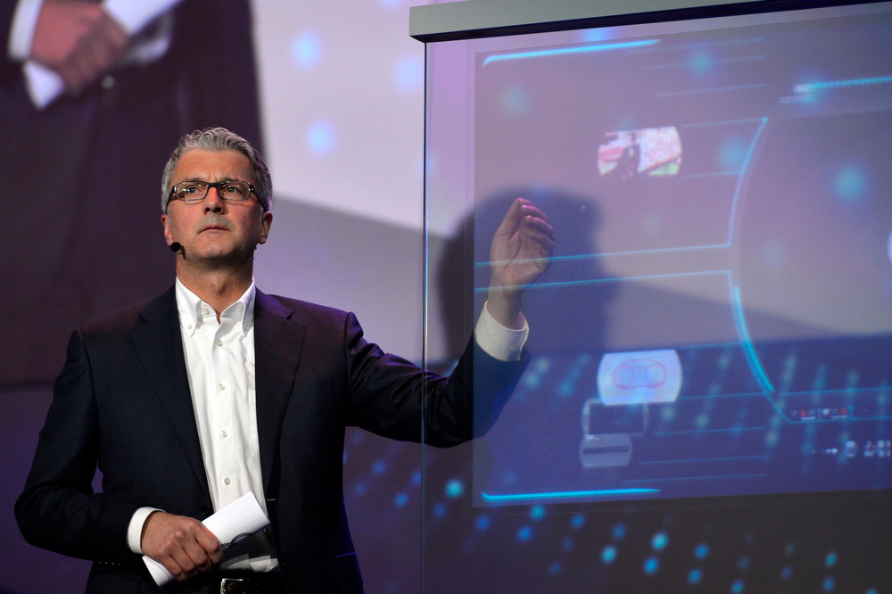 . Rupert Stadler, chairman of the board at Audi AG, talks to attendees during the Audi keynote at the International Consumer Electronics Show, Monday, Jan. 6, 2014, in Las Vegas. (AP Photo/Jack Dempsey)