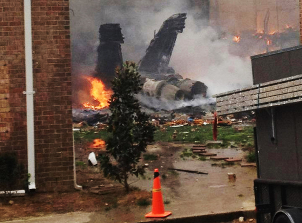 . In this April 6, 2012 file photo, the burning fuselage of an F/A-18 Hornet lies smoldering after crashing into a residential building in Virginia Beach, Va.  (AP Photo/Zach Zapatero, File)
