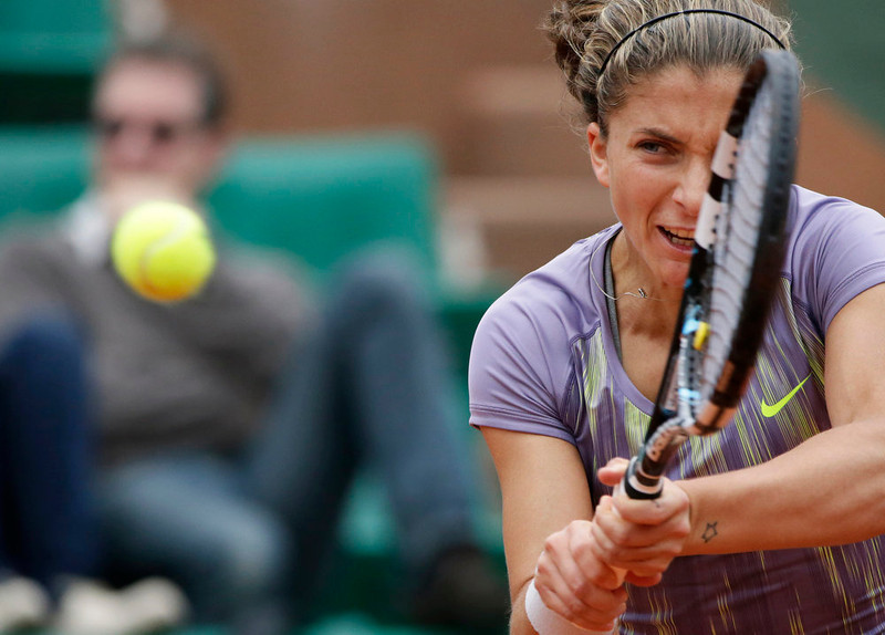 . Italy\'s Sara Errani returns to Spain\'s Carla Suarez Navarro during their French Tennis Open round of sixteen match at the Roland Garros stadium in Paris, on June 2,  2013. KENZO TRIBOUILLARD/AFP/Getty Images