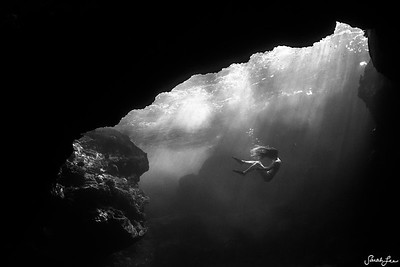 Diving under an archway in Hawaii.