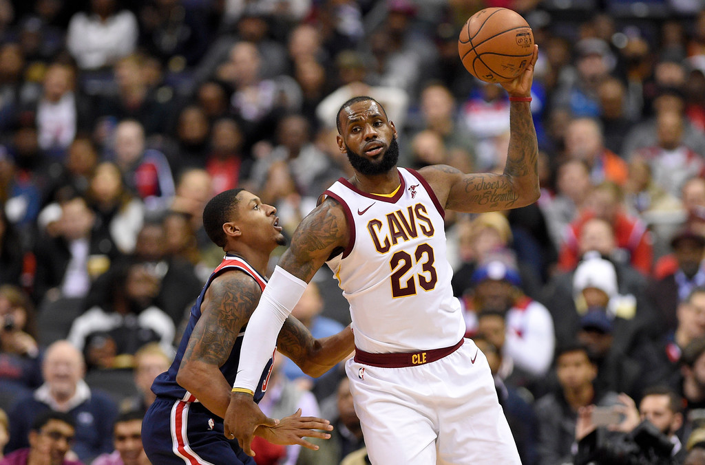 . Cleveland Cavaliers forward LeBron James (23) handles the ball against Washington Wizards guard Bradley Beal, left, during the second half of an NBA basketball game, Sunday, Dec. 17, 2017, in Washington. (AP Photo/Nick Wass)