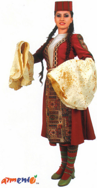 006_Armenian_girl_in_traditional_dress_Taraz_Holding_lavash.jpg