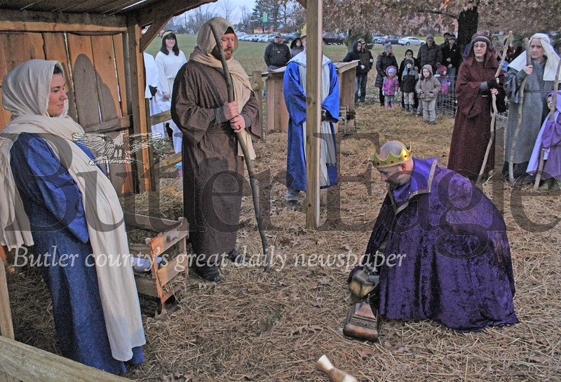 Harold Aughton/Special to the Eagle: Chris Nagg, Food Service Manager,presents a gift to Mary played by Laura Leppert and Joseph, played by John Roofner  at Concorida Lutheran Ministries 6th Annual Live Nativity.